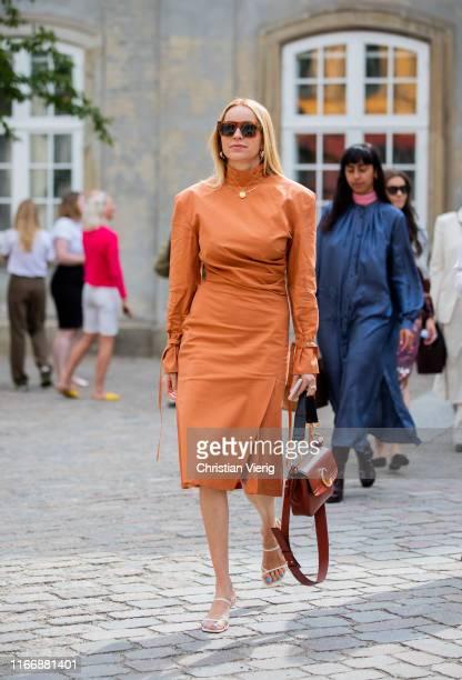 Hege Aurelie Badendyck is seen wearing Chloe bag, orange dress outside Designers Remix during Copenhagen Fashion Week Spring/Summer 2020 on August...