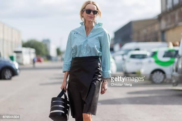 Hege Aurelie Badendyck wearing bucket bag leather skirt ankle boots outside Ganni on August 10 2017 in Copenhagen Denmark