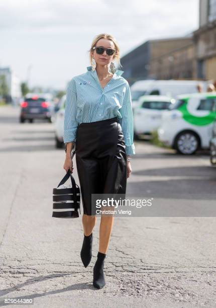 Hege Aurelie Badendyck wearing bucket bag leather skirt ankle boots outside Ganni on August 10 2017 in Copenhagen Denmark