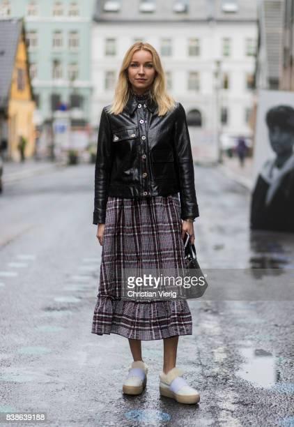 Hege Aurelie Badendyck wearing cropped pants, black Dior bag, sneakers, black leather jacket outside Bik Bok Runway Award on August 24, 2017 in Oslo,...