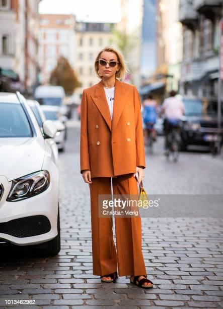 Hege Aurelie Badendyck wearing orange suit Jacquemus bag seen outside Rodebjer during the Copenhagen Fashion Week Spring/Summer 2019 on August 8 2018...