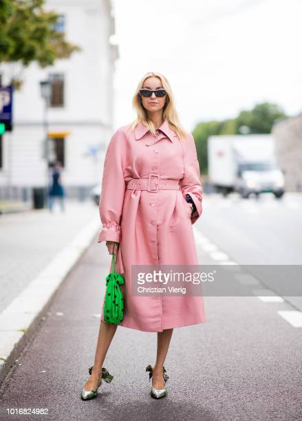 Hege Aurelie Badendyck wearing pink Stine Goya dress green mini bag green slingbacks seen outside Anne Karine Thorbjornsen during Oslo Runway SS19 on...
