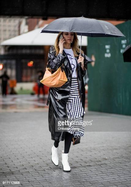 Hege Aurelie wearing brown bag Vinyl coat black white plaid skirt seen outside Tibi on February 11 2018 in New York City