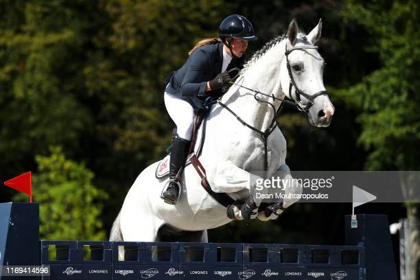 Hege C Tidemandsen of Norway riding Carvis competes during Day 3 of the Longines FEI Jumping European Championship speed competition against the...