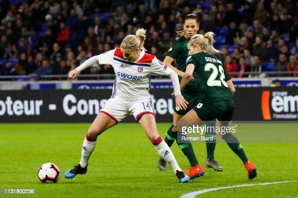 Hegerberg Ada of Lyon and Lena Groessling of Wolfsburg during the Women's Champions League match between Lyon and Wolfsburg on March 20 2019 in Lyon...