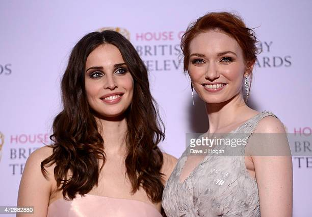 Heida Reed and Eleanor Tomlinson pose in the winners room at the House of Fraser British Academy Television Awards at Theatre Royal on May 10 2015 in...