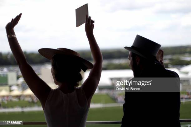 Heida Reed and Sam Ritzenberg enjoy the races at Longines host VIPs in their private suite Royal Enclosure at Royal Ascot on June 21 2019 in Ascot...