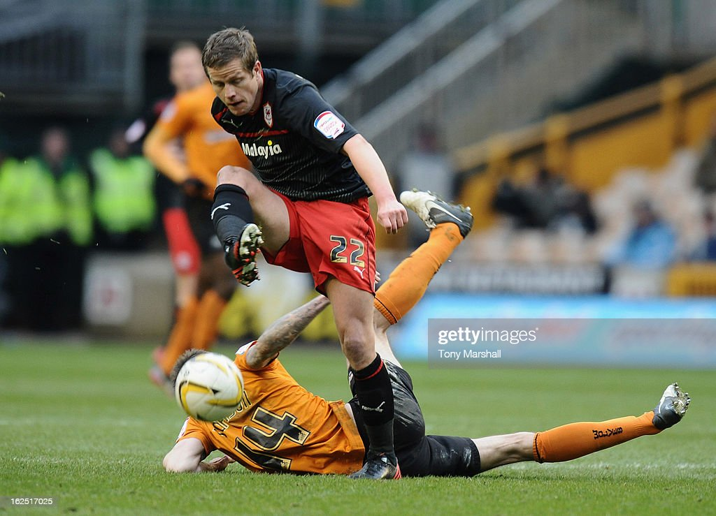 Heidar Helguson of Cardiff clashes with Roger Johnson of Wolvesl during the npower Championship match between Wolverhampton Wanderers and Cardiff City at Molineux on February 24, 2013 in Wolverhampton, England.