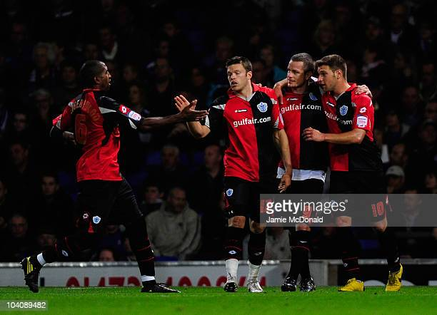 Heidar Helguson of QPR celebrates his goal with Jamie Mackie during the npower Championship match between Ipswich Town and Queens Park Rangers at...