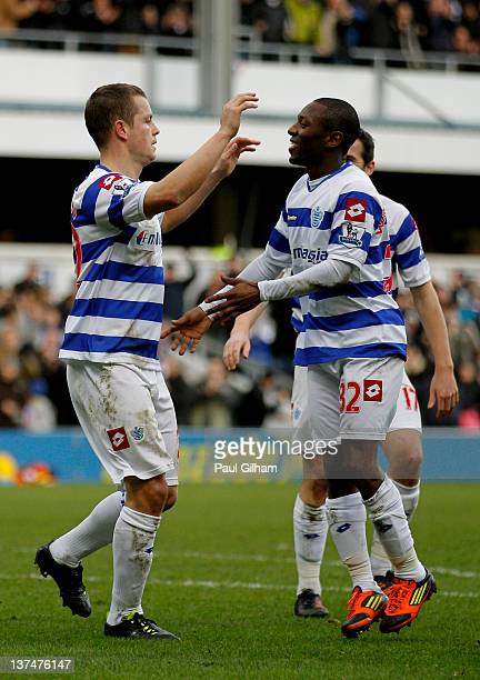 Heidar Helguson of QPR celebrates with teammate Shaun WrightPhillips after scoring the opening goal from the penalty spot during the Barclays Premier...