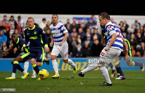 Heidar Helguson of QPR scores the opening goal from the penalty spot during the Barclays Premier League match between Queens Park Rangers and Wigan...