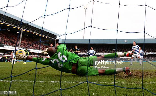 Heidar Helguson of QPR scores the opening goal from the penalty spot past goalkeeper Ali AlHabsi of Wigan during the Barclays Premier League match...