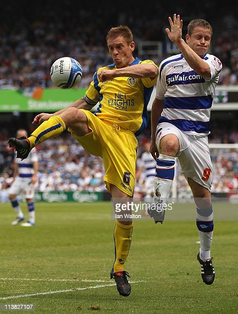 Heidar Helguson of QPR tries to tackle Richard Naylor of Leeds United during the npower Championship match between Queens Park Rangers and Leeds...