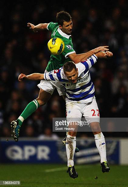 Heidar Helguson of Queens Park Rangers and Adam Drury of Norwich City challenge for the ball during the Barclays Premier League match between Queens...