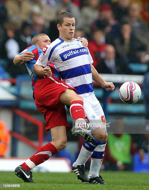 Heidar Helguson of Queens Park Rangers battles with Alex Marrow of Crystal Palace during the npower Championship match between Crystal Palace and...