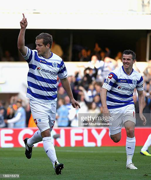Heidar Helguson of Queens Park Rangers celebrates scoring from a penalty kick with team mate Joey Barton during the Barclays Premier League match...