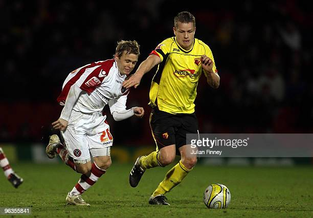 Heidar Helguson of Watford battles with Derek Geary of Sheffield United during the CocaCola Championship match between Watford and Sheffield United...