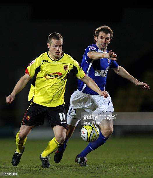 Heidar Helguson of Watford battles with Gareth McAuley of Ipswich during the CocaCola Championship match between Watford and Ipswich at Vicarage Road...