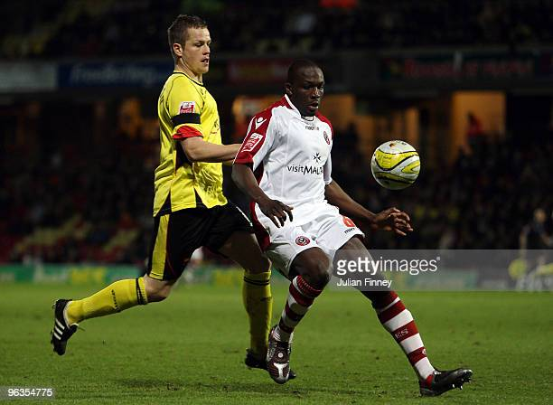 Heidar Helguson of Watford battles with Nyron Nosworthy of Sheffield United during the CocaCola Championship match between Watford and Sheffield...