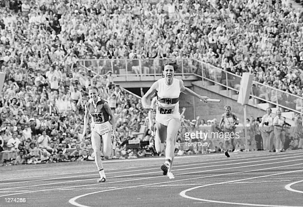 Heide Rosendahl of West Germany anchors her team to Gold in the womens 4x100m relay event at the Olympic Games in Munich West Germany Mandatory...
