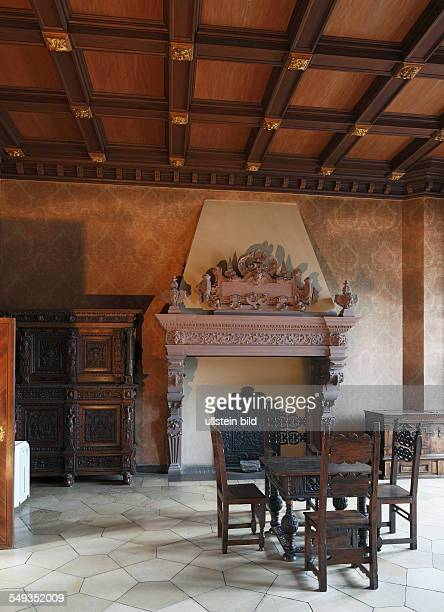Heidelberg Castle Friedrich building interior view festive room fireplace table chairs wooden ceiling