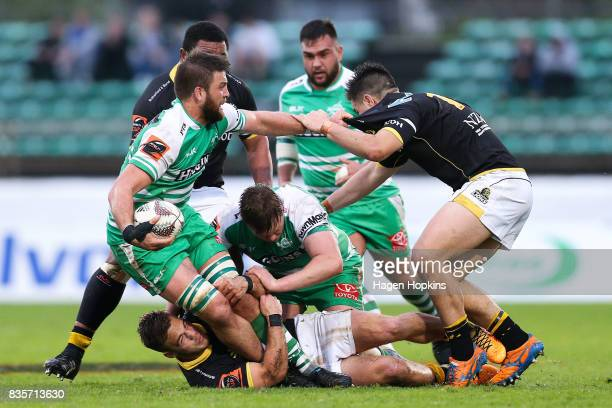 Heiden Bedwell-Curtis captain of Manawatu fends Jackson Garden-Bachop of Wellington during the round one Mitre 10 Cup match between Manawatu and...