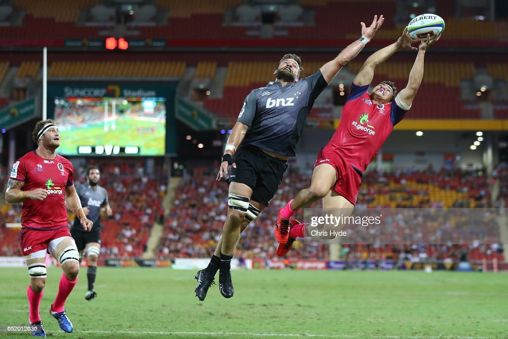 Heiden Bedwell-Curtis of Crusaders and Izaia Perese of the Reds compete for the ball during the round three Super Rugby match between the Reds and the Crusaders at Suncorp Stadium on March 11, 2017 in Brisbane, Australia.