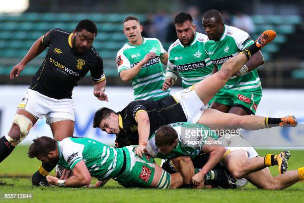 Heiden Bedwell-Curtis of Manawatu is tackled by Jackson Garden-Bachop of Wellington during the round one Mitre 10 Cup match between Manawatu and...
