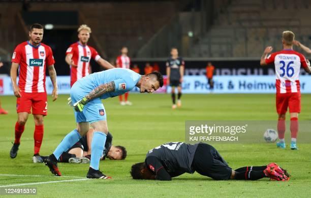 Heidenheim's German goalkeeper Kevin Mueller remonstrates with Bremen's Czech defender Theodor Gebre Selassie during the relegation second leg...