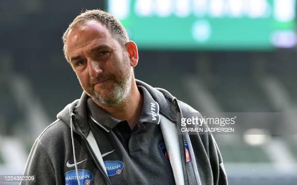 Heidenheim's head coach Frank Schmidt arrives prior to the German Bundesliga relegation first-leg football match Werder Bremen v 1 FC Heidenheim 1846...