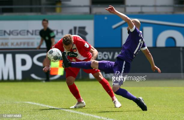 Heidenheim's Konstantin Kerschbaumer scores his teams second goal against Aues Philipp Riese to make it 2-0 during the Second Bundesliga match...
