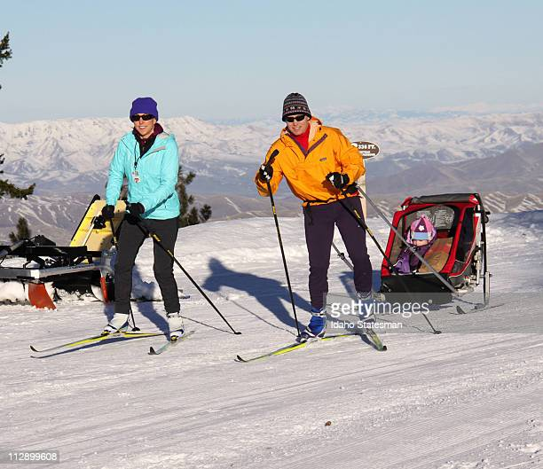 Heidi and Nate Haislmaier of Boise Idaho tow their daughter Addy in a kids sled on the Nordic trails at Bogus Basin