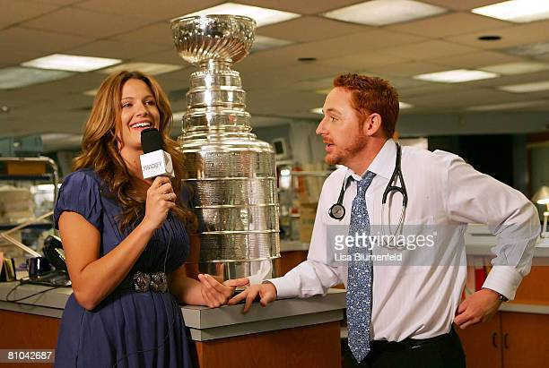 Heidi Androl of The Hockey Show interviews Actor Scott Grimes with the Stanley Cup on the set of ER at Warner Bros Studios on May 9 2008 in Burbank...