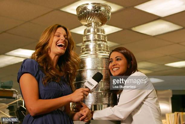 Heidi Androl of The Hockey Show interviews actress Parminder Nagra with the Stanley Cup on the set of ER at Warner Bros Studios on May 9 2008 in...