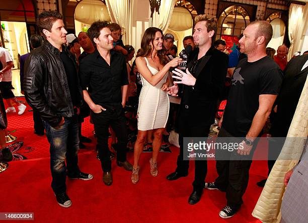 Heidi Androl of the NHL Network interviews Chad Kroeger of Nickelback as the band arrives before the 2012 NHL Awards at the Encore Theater at the...