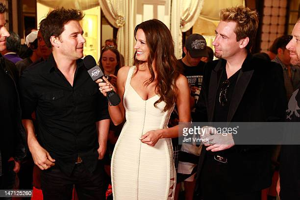 Heidi Androl of the NHL Network interviews members of the band Nickelback as the band arrive before the 2012 NHL Awards at the Encore Theater at the...