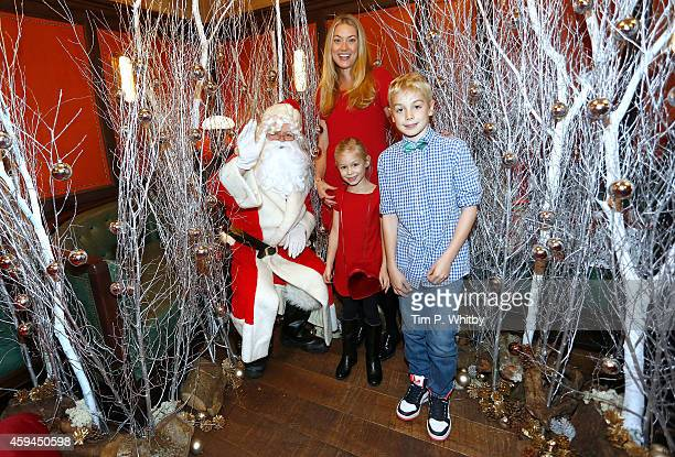 Heidi Bishop and her children pose for a photo with Father Christmas at the brunch launch of The Ivy Market Grill in partnership with the Kids...
