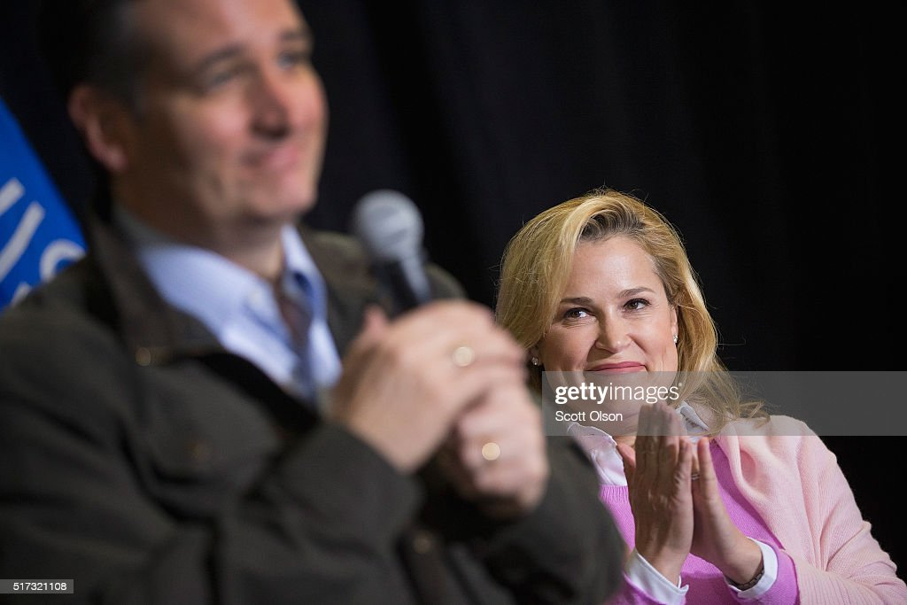 Heidi Cruz listens as her husband Republican presidential candidate Sen. Ted Cruz (R-TX) speaks to workers at Dane Manufacturing during a campaign stop on March 24, 2016 in Dane, Wisconsin. Wisconsin voters go to the polls for the state's primary on April 5.