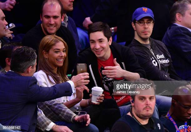 Heidi Dela Rosa and Justin Long attend the New York Knicks Vs Dallas Mavericks game at Madison Square Garden on March 13 2018 in New York City