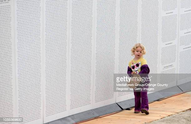 Heidi Dye of Whittier walks along some of the 11000 names of victims veterans and first responders who died in 9/11 Operation Iraqi Freedom Operation...