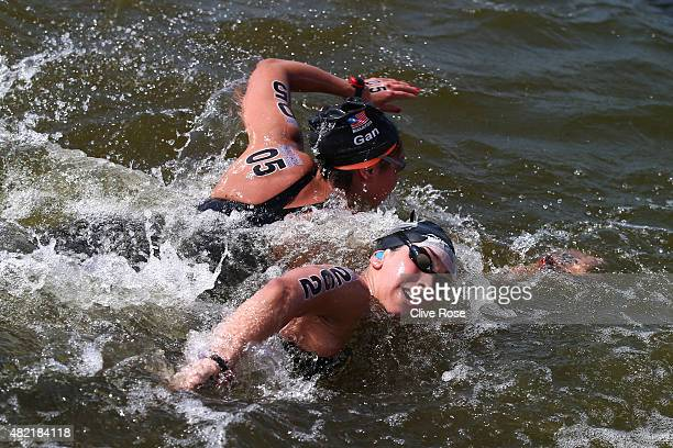 Heidi Gan of Malaysia and Julia Lucila Arino of Argentina compete in the Women's 10km Open Water Swimming Final on day four of the 16th FINA World...