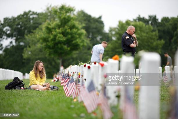 Heidi Heming pays her respects to a comrade lost in Afghanistan at Arlington National Cemetery on Memorial Day May 27 2018 in Arlington Virginia...