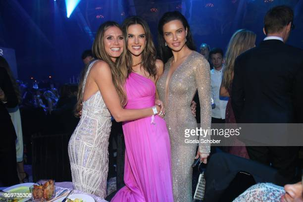 Heidi Klum Alessandra Ambrosio and Adriana Lima attend the amfAR Gala Cannes 2018 dinner at Hotel du CapEdenRoc on May 17 2018 in Cap d'Antibes France