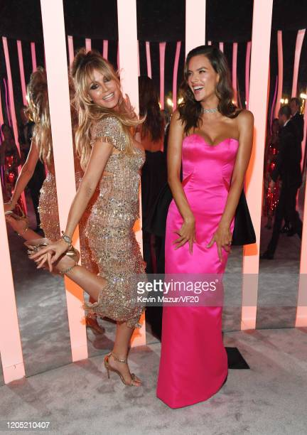 Heidi Klum and Alessandra Ambrosio attend the 2020 Vanity Fair Oscar Party hosted by Radhika Jones at Wallis Annenberg Center for the Performing Arts...