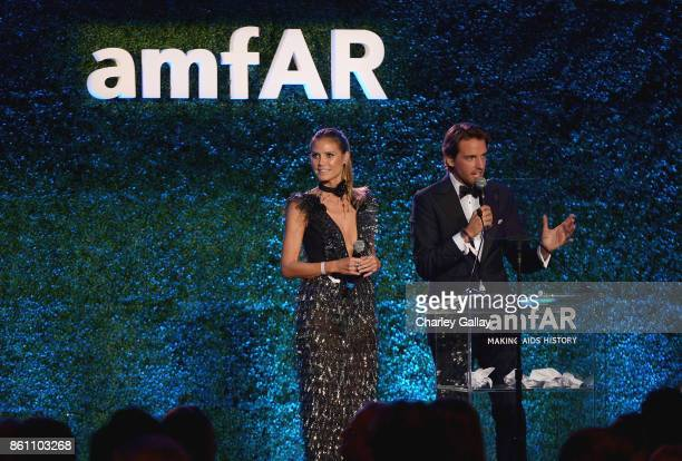 Heidi Klum and Alexander Gilkes speak onstage during the amfAR Gala Los Angeles 2017 at Ron Burkle's Green Acres Estate on October 13 2017 in Beverly...