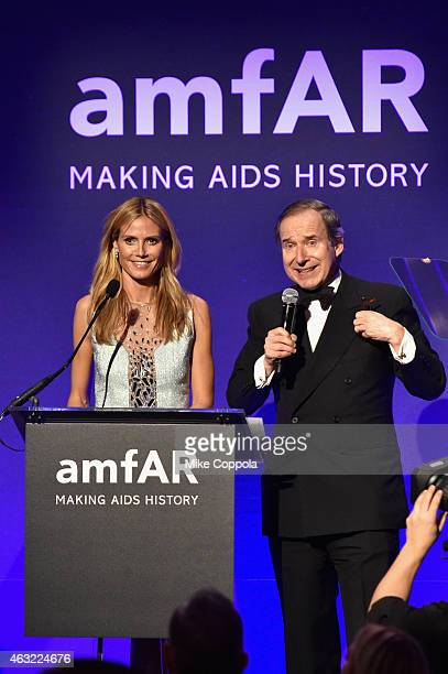 Heidi Klum and auctioneer Simon de Pury speak onstage at the 2015 amfAR New York Gala at Cipriani Wall Street on February 11, 2015 in New York City.