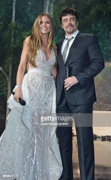 Heidi Klum and Benicio Del Toro attend the amfAR Gala Cannes 2018 at Hotel du CapEdenRoc on May 17 2018 in Cap d'Antibes France