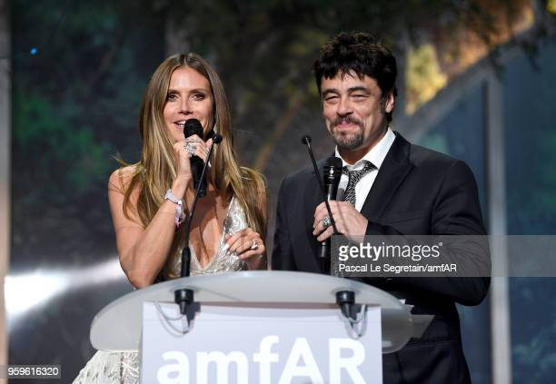 Heidi Klum and Benicio del Toro on stage at the amfAR Gala Cannes 2018 at Hotel du CapEdenRoc on May 17 2018 in Cap d'Antibes France