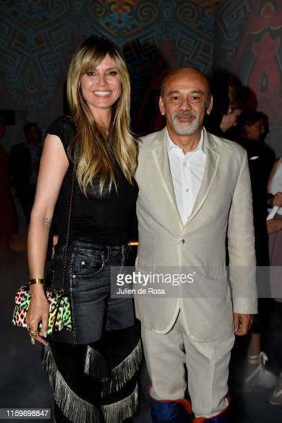 Heidi Klum and Christian Louboutin attend Loubhoutan Express presentation at La Garde Republicaine on July 02 2019 in Paris France