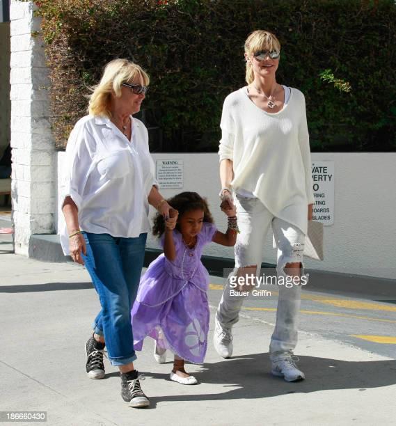 Heidi Klum and daughter Lou Samuel are seen on November 2 2013 in Los Angeles California